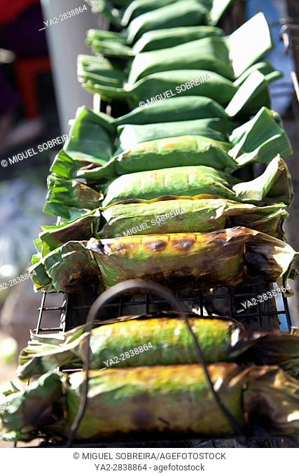 Grilled Rice Parcels Wrapped in Banana Leaf at Psa Leu Market in Siem Reap - Cambodia