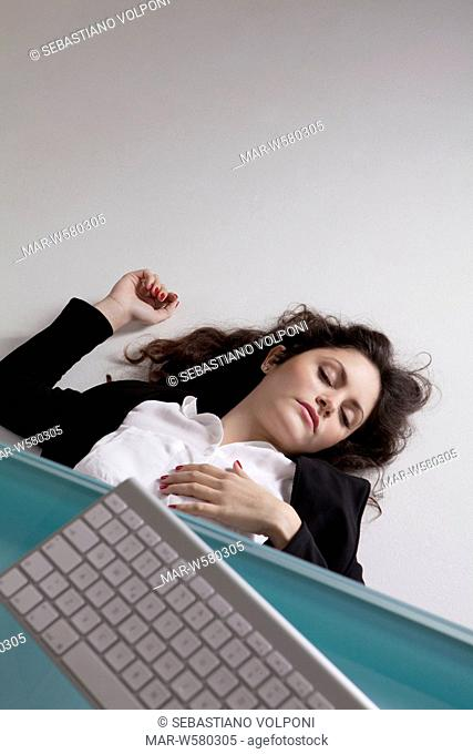 woman lying on the floor in the office