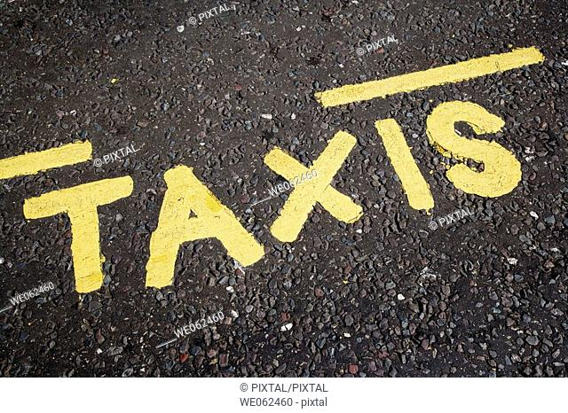 Taxis sign on road, London. England, UK