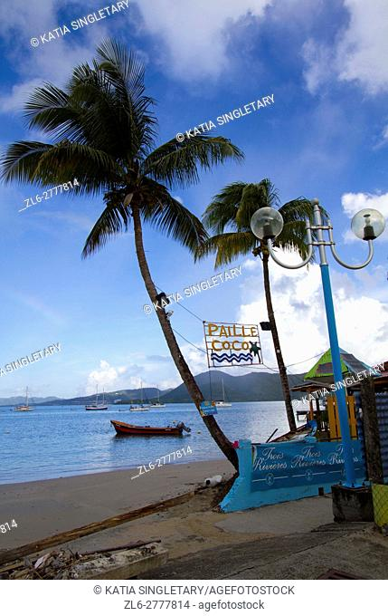 The quiet downtown of Sainte-Anne in Martinique South. The very famous and only internet cafe Paille Coco, and the view of the diamant from the baie