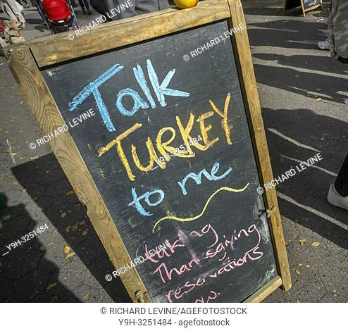 A sign reminds shoppers prior to Thanksgiving that local turkeys are available for pre-order in the Union Square Greenmarket in New York on Wednesday