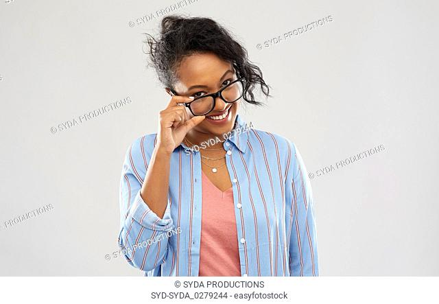 happy smiling african american woman in glasses