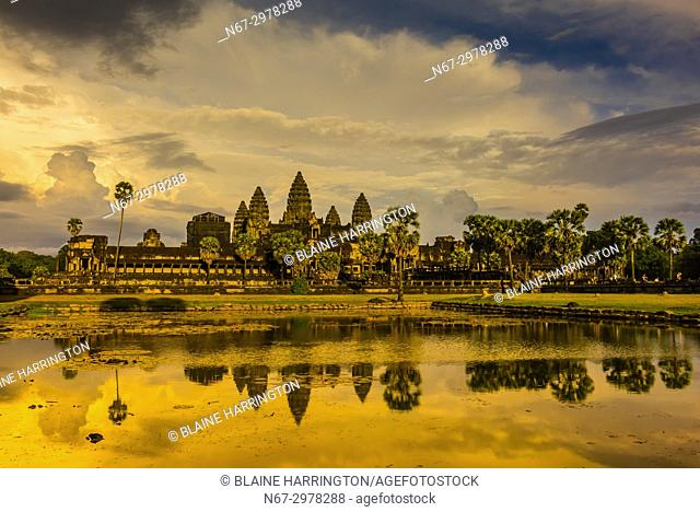View of Angkor Wat with pond. It is the largest religious monument in the world. It's name means City which is a temple; Cambodia