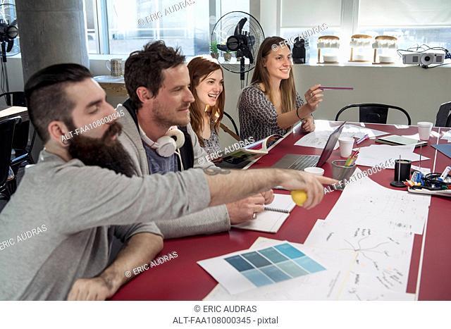 Creative colleagues brainstorming in meeting