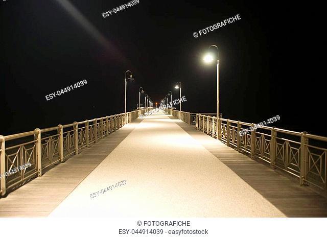 Night view of the pier of Marina di Pietrsanta riviera of Versilia Tuscany Italy