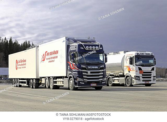 Forssa, Finland - March 30, 2019: Two Next Generation Scania R580 trucks pulling full trailer parked on truck stop yard on a day of spring