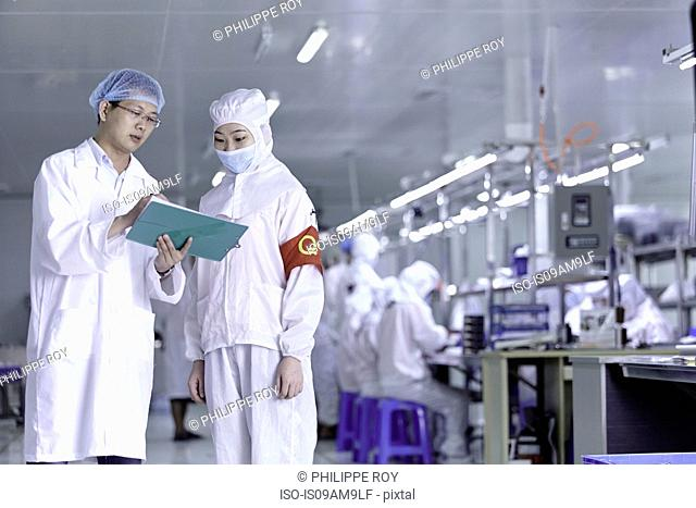 Workers having discussion in ecigarette factory