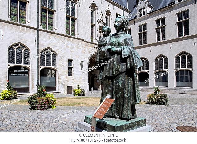 Statue De Moeder / The Mother by sculptor Ernest Wynants in the courtyard of the Mechelen / Malines city hall, Flanders, Belgium