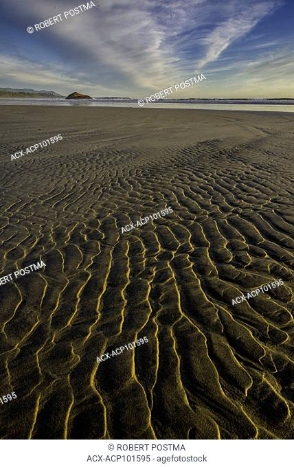 Patterns in the sand at low tide seen while walking down Long Beach in Pacific Rim National Park, British Columbia