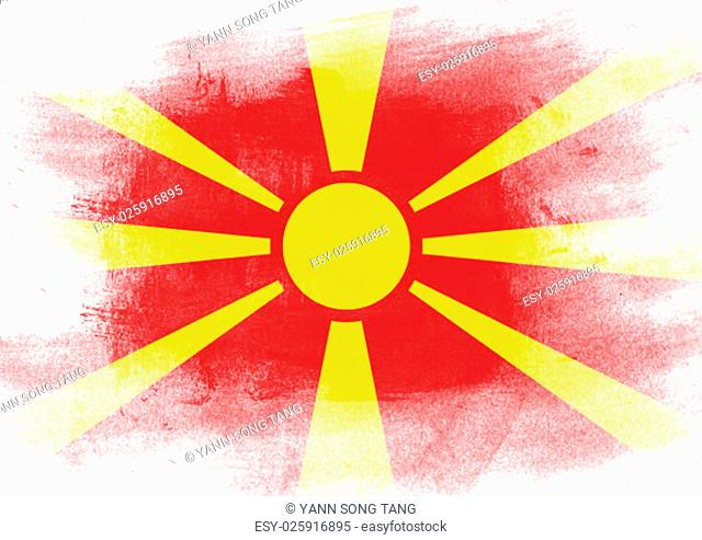 Flag of Macedonia painted with brush on solid background