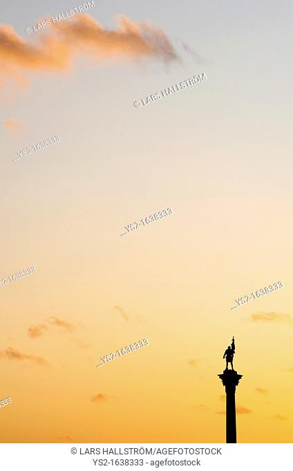Statue on a pedestal and Orange Sky