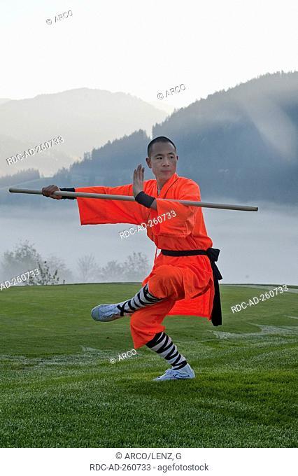 Shaolin monk with stick Kung Fu Qigong Chigong Chi Gong Chi-Kung Qi-Gong