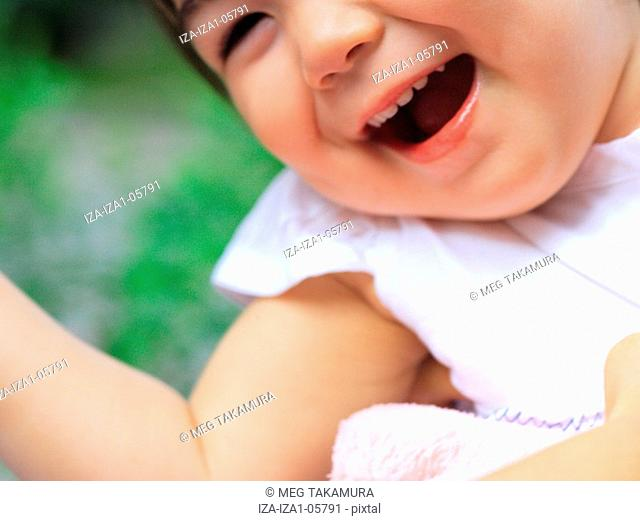 Close-up of a baby girl laughing