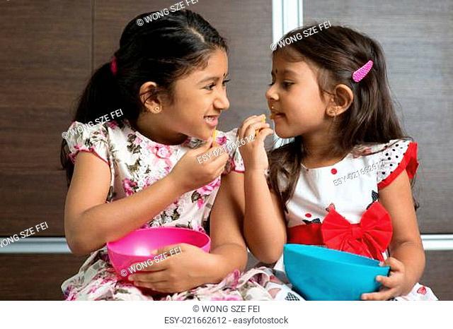 Indian girls eating