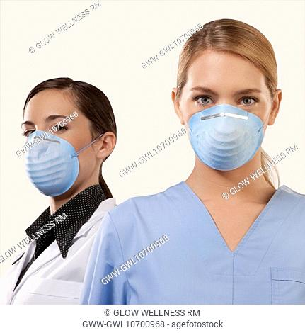 Portrait of two female doctors wearing flu masks