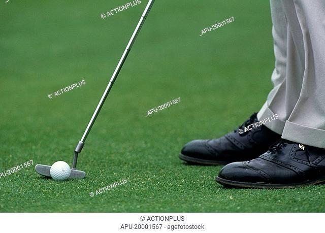 Golfer putting a ball