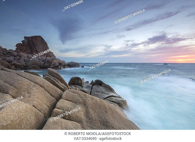 Sunset on modeled cliffs by wind framing blue sea Capo Testa Santa Teresa di Gallura Province of Sassari Sardinia Italy Europe