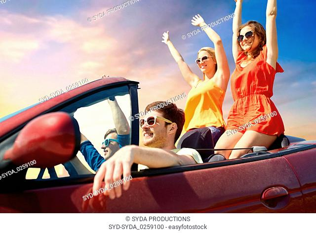 friends driving in convertible car over sky