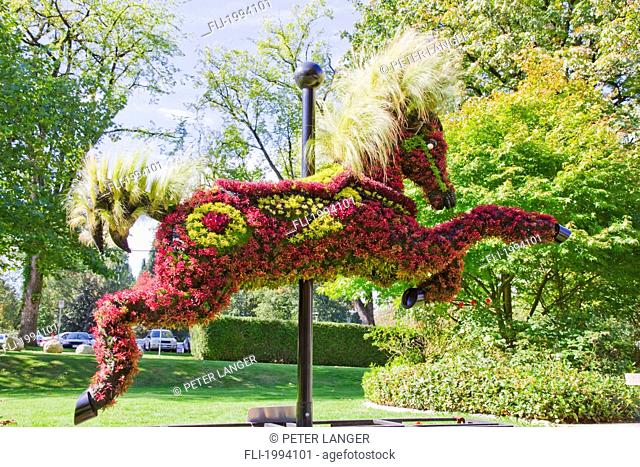 Ornamental Hedge In The Shape Of A Carousel Horse In Front Of The Shadbolt Centre For The Arts, Burnaby, British Columbia, Canada