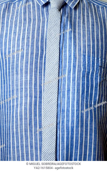 Man in blue striped shirt with skinny tie