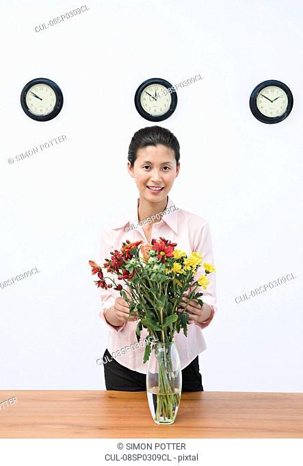 A business woman arranging flowers