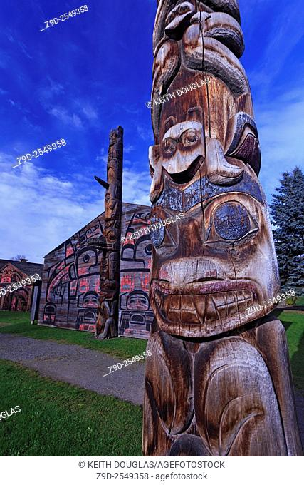 Totem pole and long houses at Ksan Historical Village and Museum, Hazelton, British Columbia