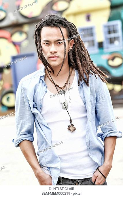 Serious Chinese man with dreadlocks