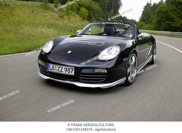 Speedart Porsche Boxster, model year 2005, black/silver, open top, driving, diagonal from the front, frontal view, test track, Tuning