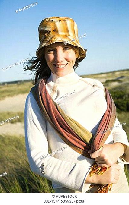 Woman standing on the beach and smiling