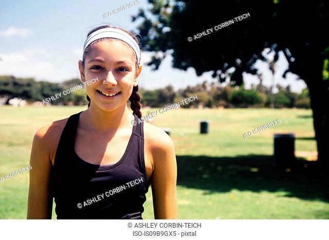 Portrait of schoolgirl on school sports field