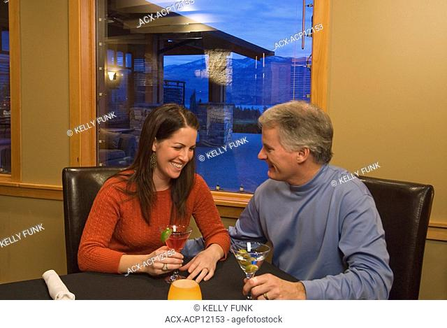 A couple enjoys a cocktail at Vintage Hills restaurant in Westbank, British Columbia, Canada
