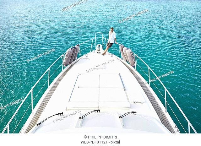 Mature man on deck of his motor yacht