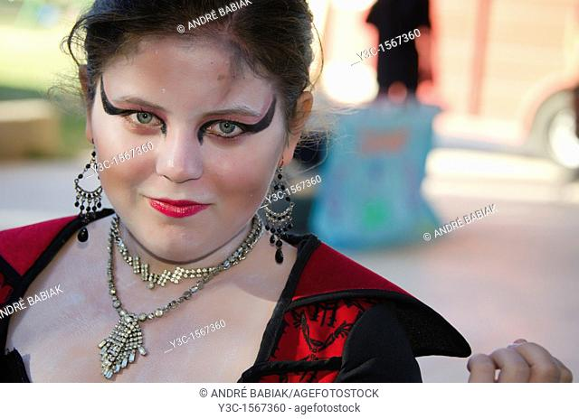 Young lady in female vampire Halloween costume