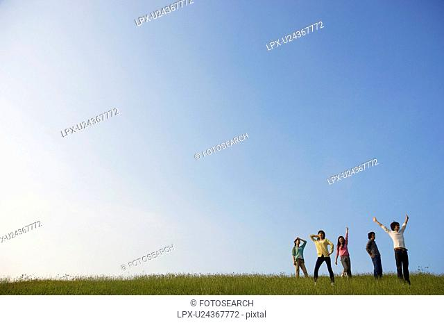 Friends playing around in a field