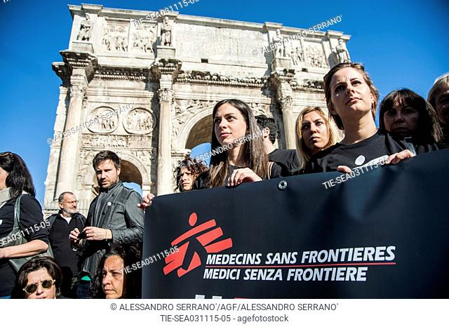 Activists of Medecins Sans Frontieres during the flash mob for the request of an indipendent investigation after the bombing in the hospital of Kunduz, Coliseum