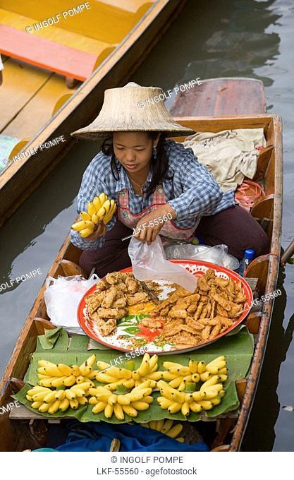 Woman in a wooden canoe at Floating Market, Damnoen Saduak, near Bangkok, Ratchaburi, Thailand