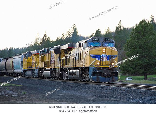 A Union Pacific train crosses a road near Spokane, Washington, USA