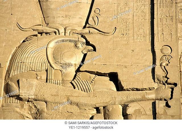 The ancient Egyptian god Horus sculpted on the wall of the First Pylon at the Temple of Edfu, Edfu, Egypt