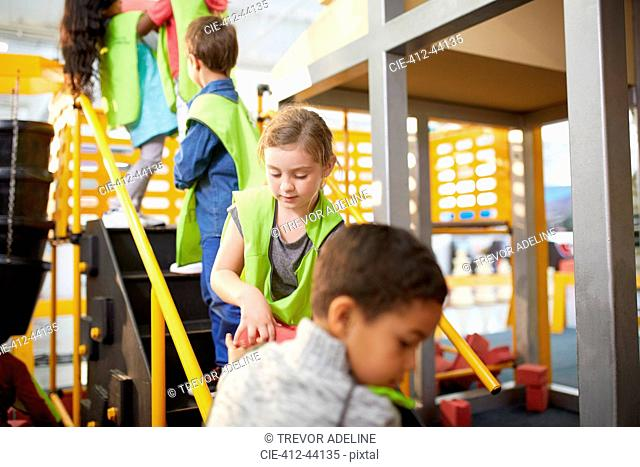 Kids playing at interactive construction exhibit in science center
