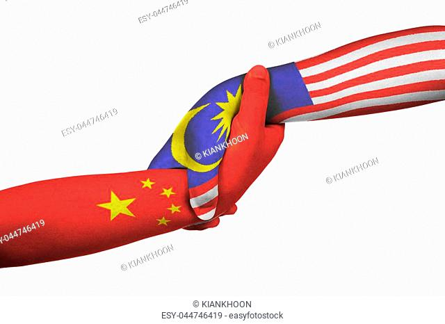 Helping hands of China and Malaysia with flags painted on child's hands in isolated white background