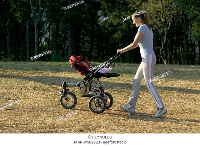 mom makes fitness at the park with stroller