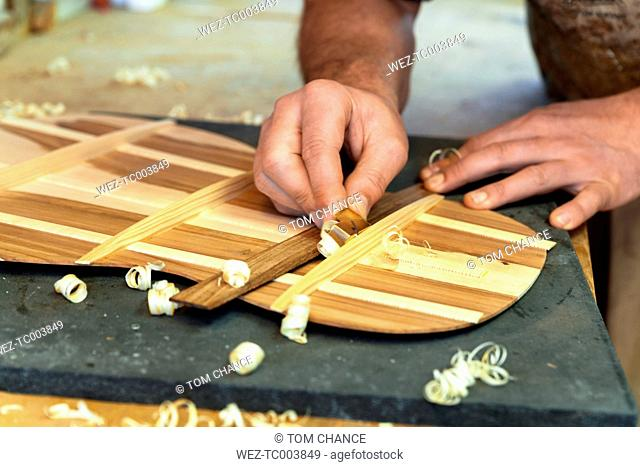 Guitar maker in his workshop, close-up