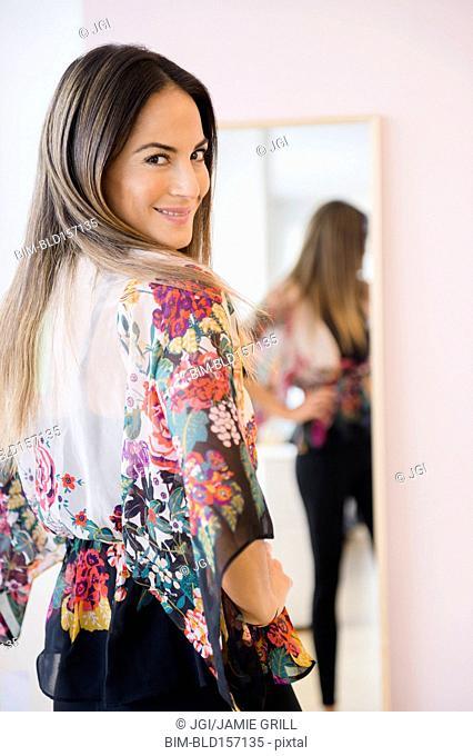 Caucasian woman looking over her shoulder
