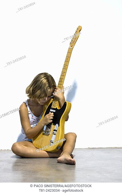 girl playing electric guitar telecaster, studio in Valencia, Spain