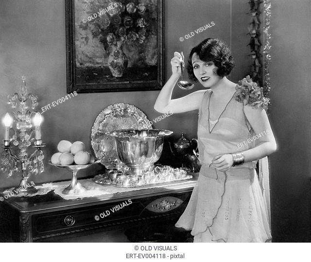 Portrait of woman with ladle and punch bowl All persons depicted are not longer living and no estate exists Supplier warranties that there will be no model...