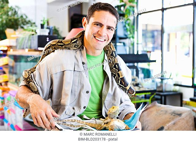 Mixed race pet store owner with animals