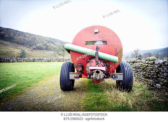 Agricultural trailer with fertilizer tank. Hubberholme, Skipton, Yorkshire Dales, North Yorkshire, England, UK, Europe
