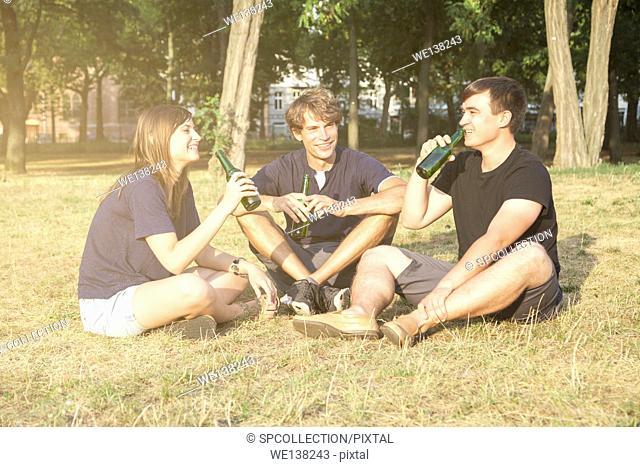 Friends in a park in summertime