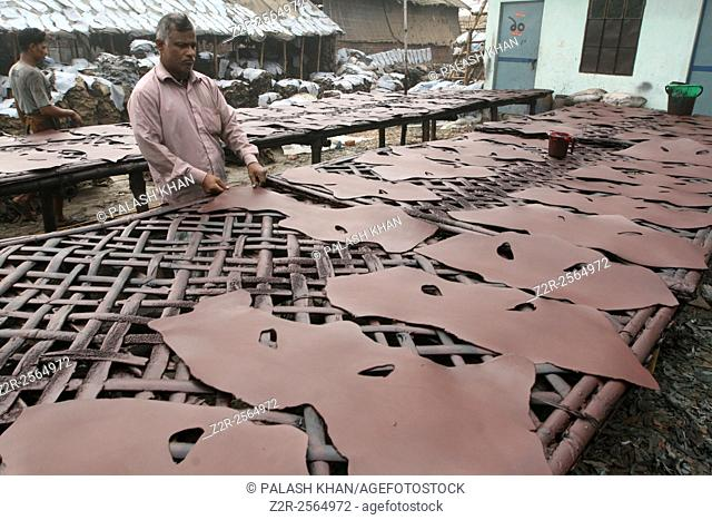 Dhaka 14 December 2014. Man working in a leather factory at Hazaribagh, in Dhaka. Human Rights Watch (HRW) has accused tanneries in Bangladesh of systemic human...