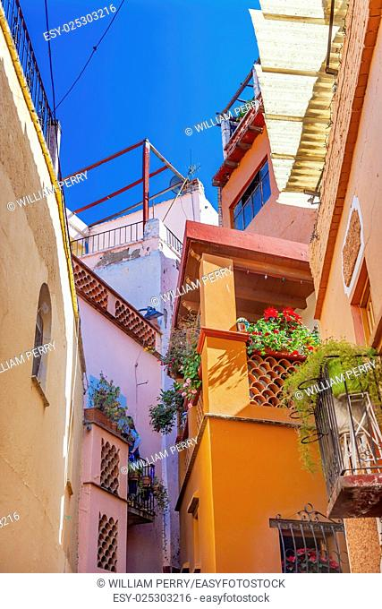 Kiss Alley Alleyway People Colored Houses Guanajuato Mexico. Houses so close couple can exchange a kiss between balconies